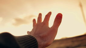 Human hand in the sunset stock footage