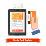 Human hand swiping credit card on tablet dongle Royalty Free Stock Images