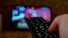 Human hand switching the channels on the TV remote control. 4K UltraHD video stock video footage
