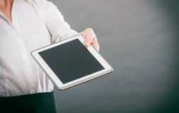 Human hand with tablet. Royalty Free Stock Image