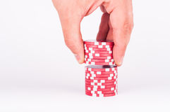 Human hand takeing red casino chips isolated on white Stock Images