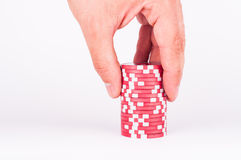 Human hand takeing red casino chips isolated on white Royalty Free Stock Images