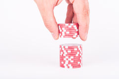 Human hand takeing red casino chips isolated on white Stock Photo