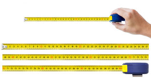 Human hand with tape-measure Royalty Free Stock Images