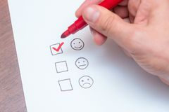 Human hand, tick placed on excellent check box. Customer service, satisfaction, survey form stock images