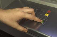 Human hand touching ATM machine Stock Photos