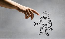 Funny sketched robot. Human hand touching with finger robot sketched design Stock Photos