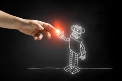 Funny sketched robot. Human hand touching with finger robot sketched design Royalty Free Stock Photos