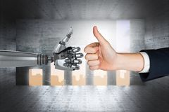 Human hand touching robot hand against graphics background Royalty Free Stock Photo