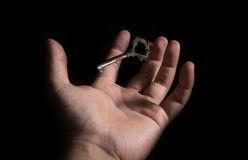 Human hand try to keep key. Stock Photos