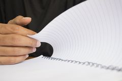 Human hand turning page.  stock photography