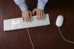 Human hand typing on computer keyboard, elevated view Stock Photography