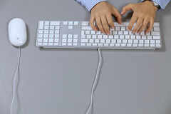 Human hand typing on computer keyboard, elevated view Royalty Free Stock Image