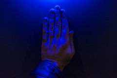 Human Hand Under Blue Light Royalty Free Stock Photo