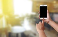 Human hand use mobile phone Royalty Free Stock Image
