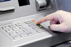 Human hand using ATM machine Stock Photos
