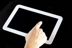 Human hand using blank touch screen device Stock Images