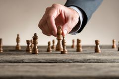Free Human Hand Wearing Business Suit Moving Dark King Chess Piece Royalty Free Stock Images - 108847359
