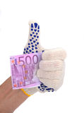 The human hand in white blue glove holds five hundred euros Royalty Free Stock Photography