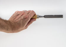 Human hand working with chisel tool Stock Photo