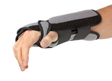 Human hand with a wrist brace stock photos