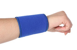 Human hand with a wrist brace Stock Photo