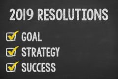 Human Hand Writing New Year 2019 Resolutions on Chalkboard. New year concepts royalty free stock photos