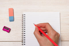 Human hand writing in notebook Royalty Free Stock Image