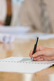 Human hand writing on notepad Royalty Free Stock Photos