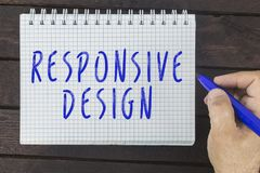 Hand writing on notepad: Responsive design stock photography