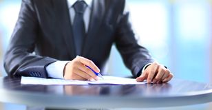 Human hand writing on a paper. Royalty Free Stock Photos