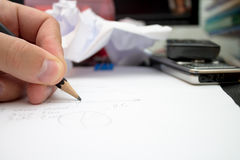 Human hand writing on a paper. Stock Photo