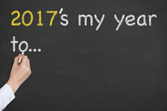 Human Hand Writing 2017`s my year to... on Chalkboard Stock Image