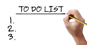 Human hand writing the to do list. Stock Photography