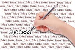 Human hand writing word's success Stock Photos