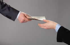 Human hands accepting an offer of money. On grey background stock images