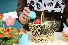 Human hands arranging easter eggs Stock Photography