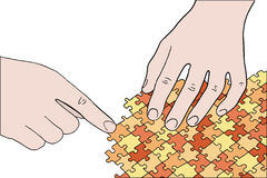 Human hands assembling puzzle Royalty Free Stock Photo