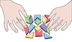 Human hands assembling puzzle Stock Photos