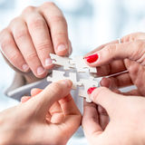 Human Hands Assembling Puzzle Pieces Stock Images
