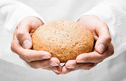 Human hands with bread Royalty Free Stock Photos