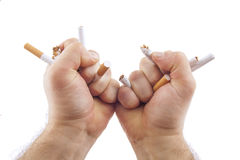 Human hands breaking cigarettes Royalty Free Stock Photography