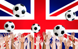 Human Hands with British Flag as a Background Royalty Free Stock Photography