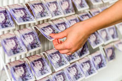 Human Hands On British Sterling Pounds Notes On Clothes Dryer. Money Laundering Concept Royalty Free Stock Images
