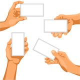 Human hands with business cards in them Royalty Free Stock Photo