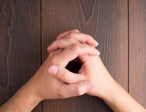 Human hands clasped Stock Photos