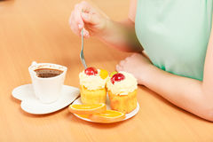 Human hands with coffee and cake. Gluttony. Stock Image
