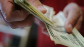 Human hands counting dollar bills. Close up of hands count money cash. American money calculation in bank office. Us dollar money income concept. Finance stock footage