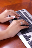 Human hands doing some computer work Royalty Free Stock Photos