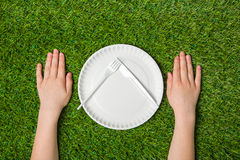 Human hands empty paper plate with fork and knife Stock Photos